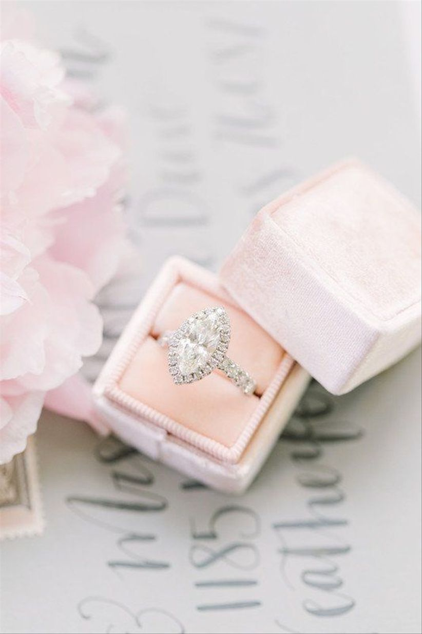 vintage marquise cut engagement ring with diamond halo and blush velvet ring box