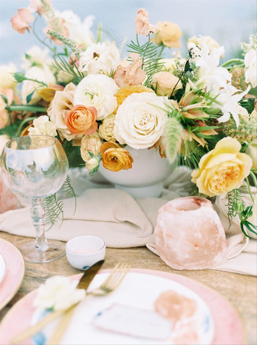 blush and yellow centerpiece for bohemian wedding with Himalayan salt decor