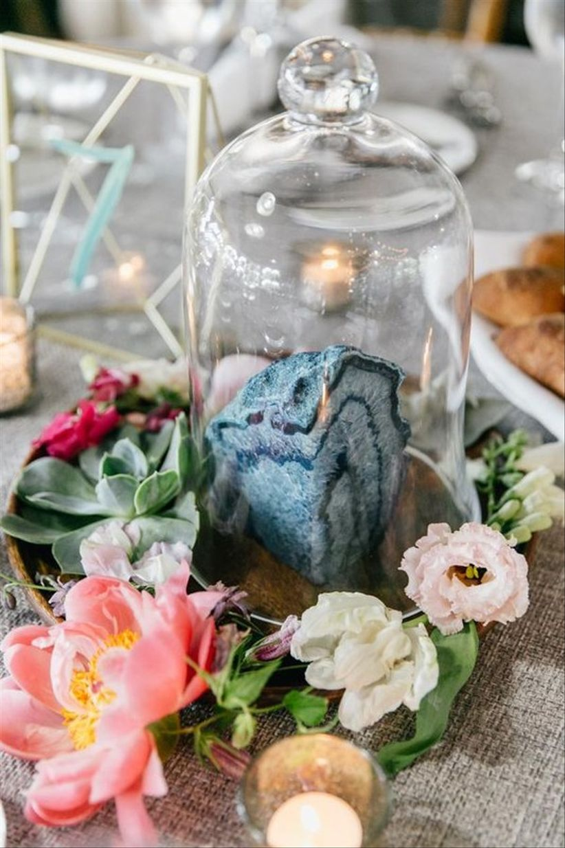 whimsical blue and pink wedding centerpiece with geode inside cloche jar and coral peonies