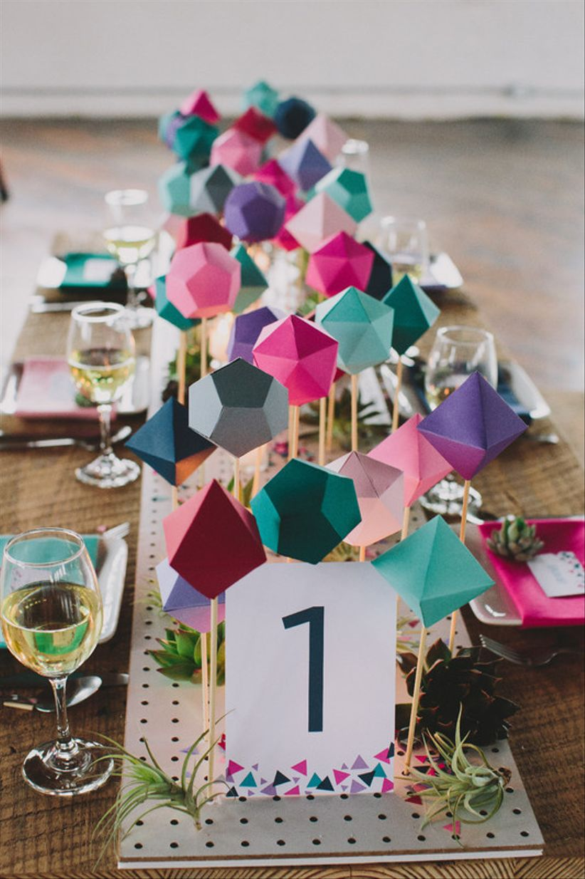 geometric wedding centerpiece with 3D paper shapes