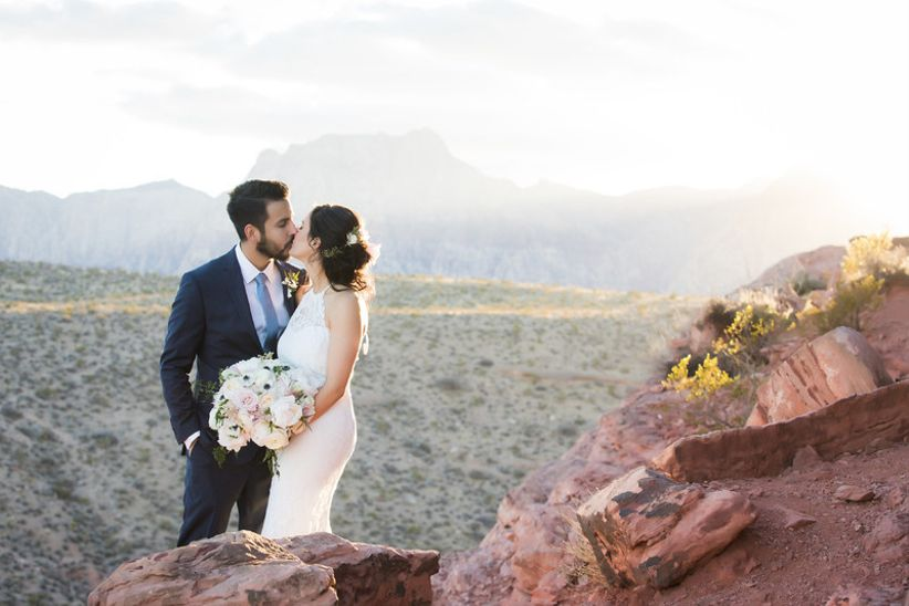 bride and groom kiss at Las Vegas desert elopement