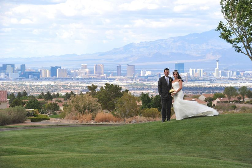 bride and groom pose at scenic Las Vegas golf resort overlooking downtown skyline