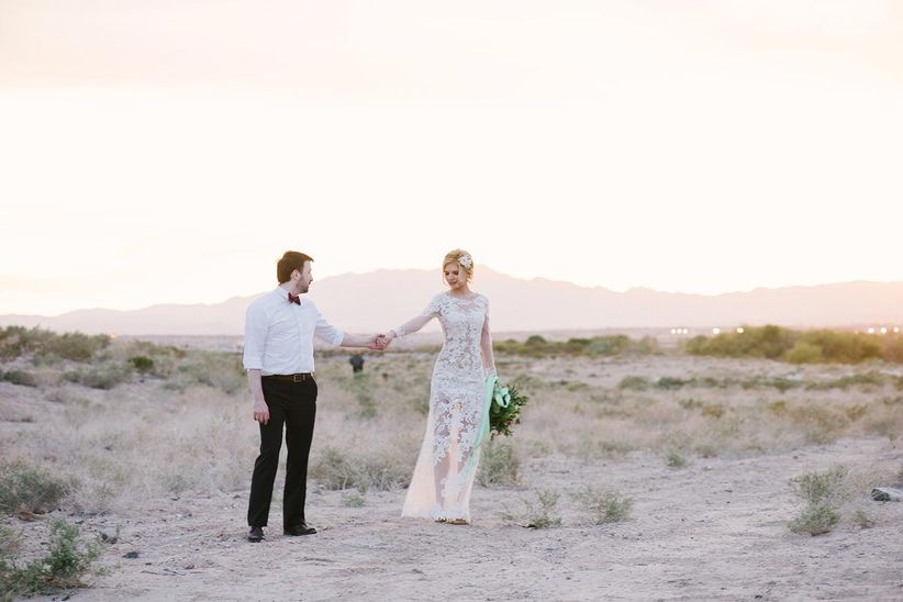 bride and groom posing at desert wedding venue in Las Vegas