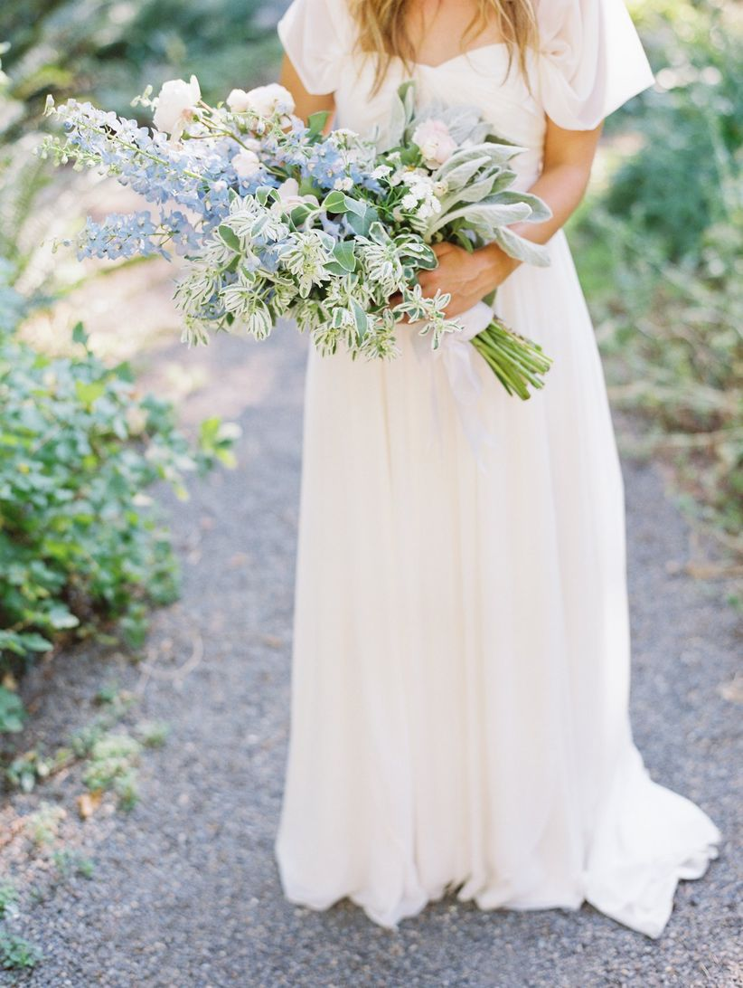 presentation wedding bouquet with blue delphinium and greenery