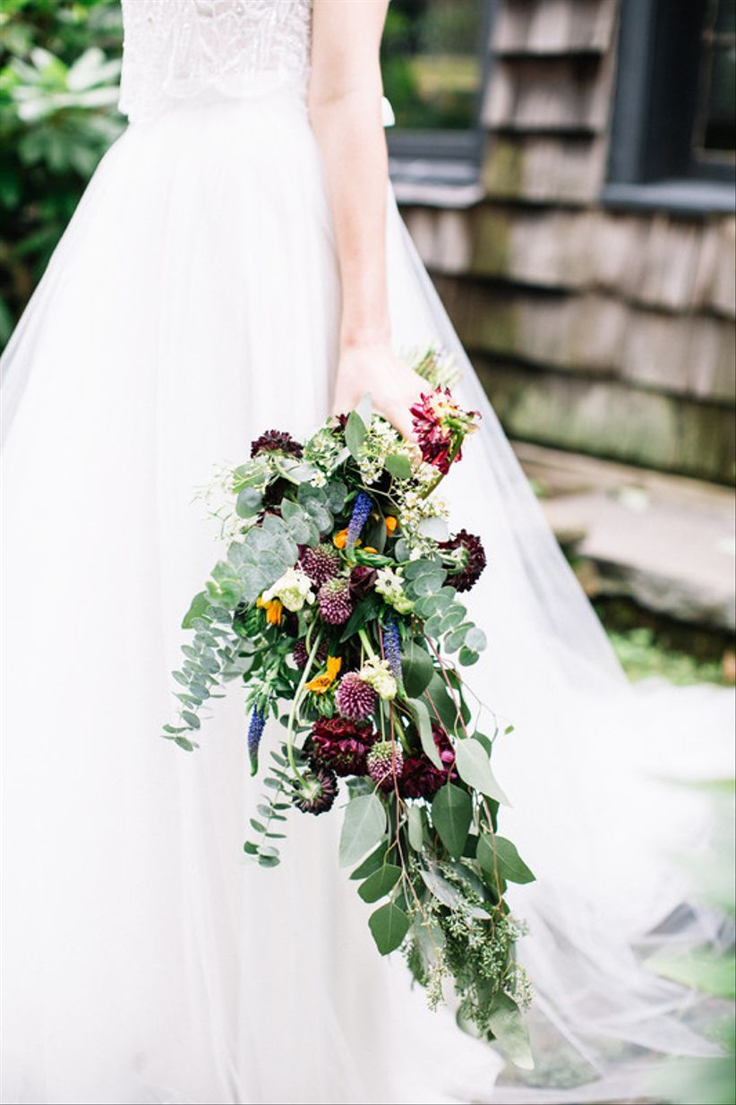 oversized fall wedding bouquet with greenery and purple flowers