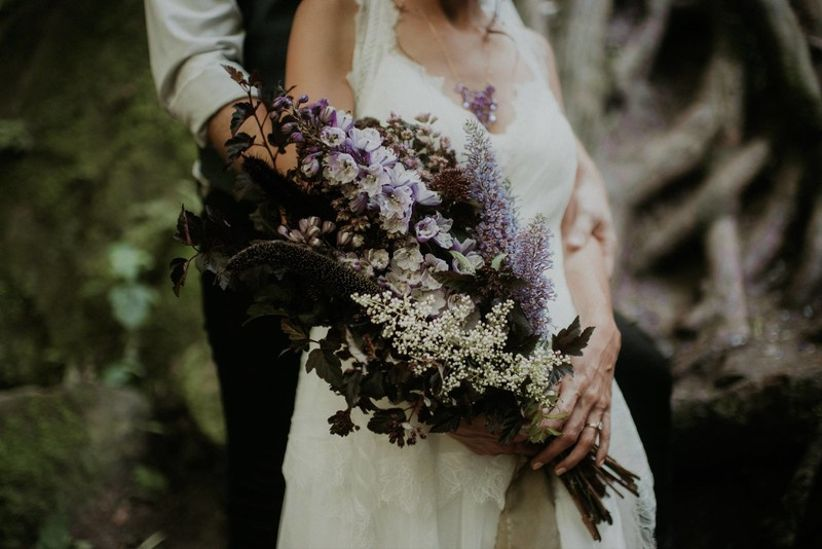 oversized fall wedding bouquet with dark purple and white flowers