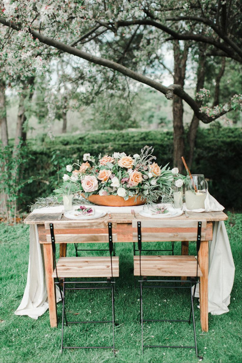 simple rustic wedding tablescape with oversized centerpiece and fabric runner