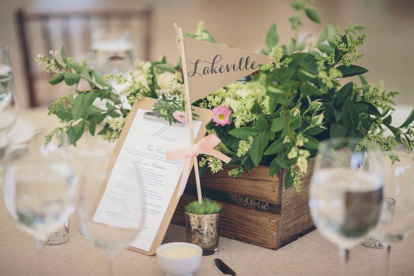 rustic wedding centerpiece in square wooden vessel with paper flag table name