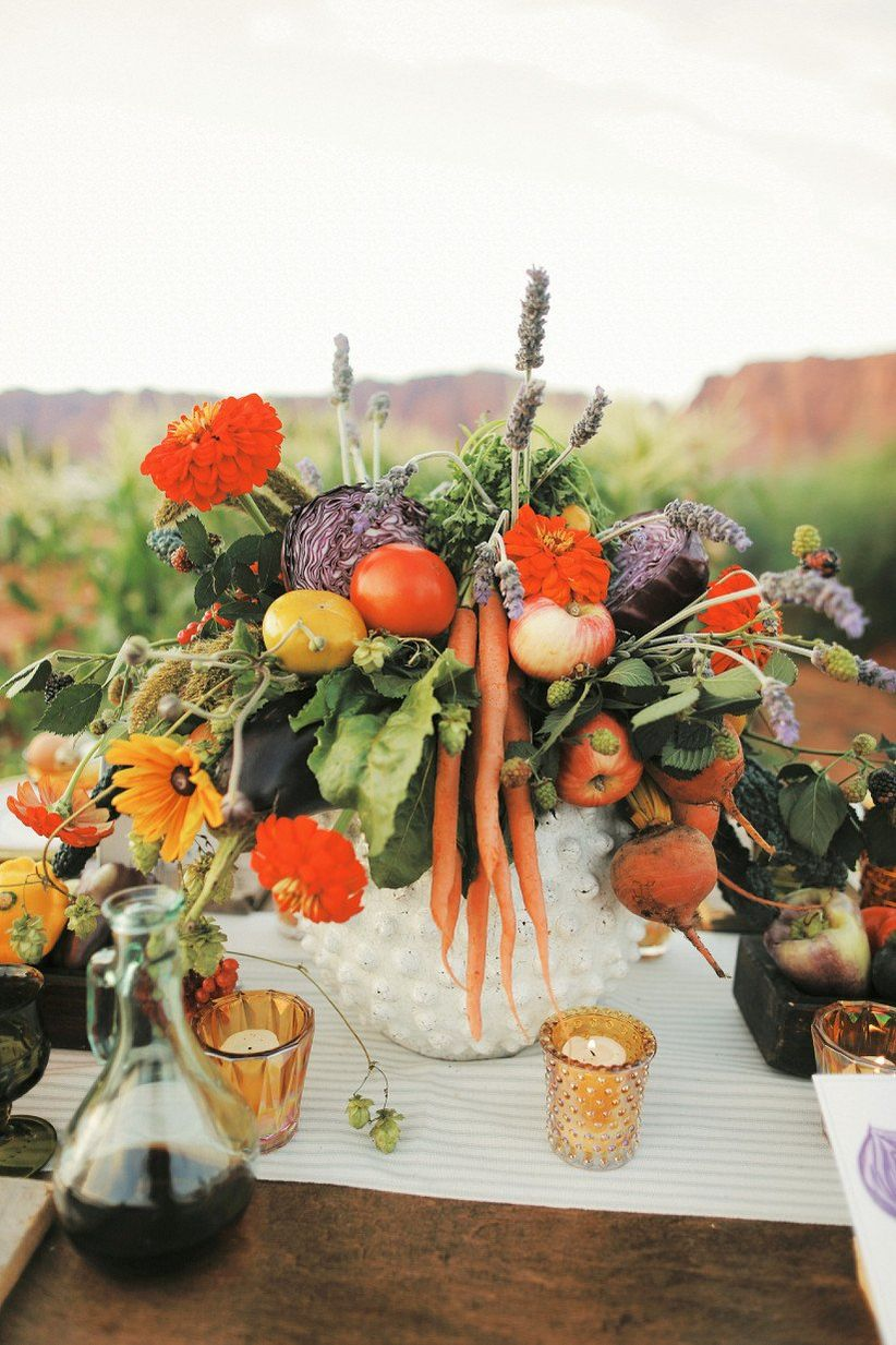 farm-to-table wedding centerpiece with fresh vegetables and candles