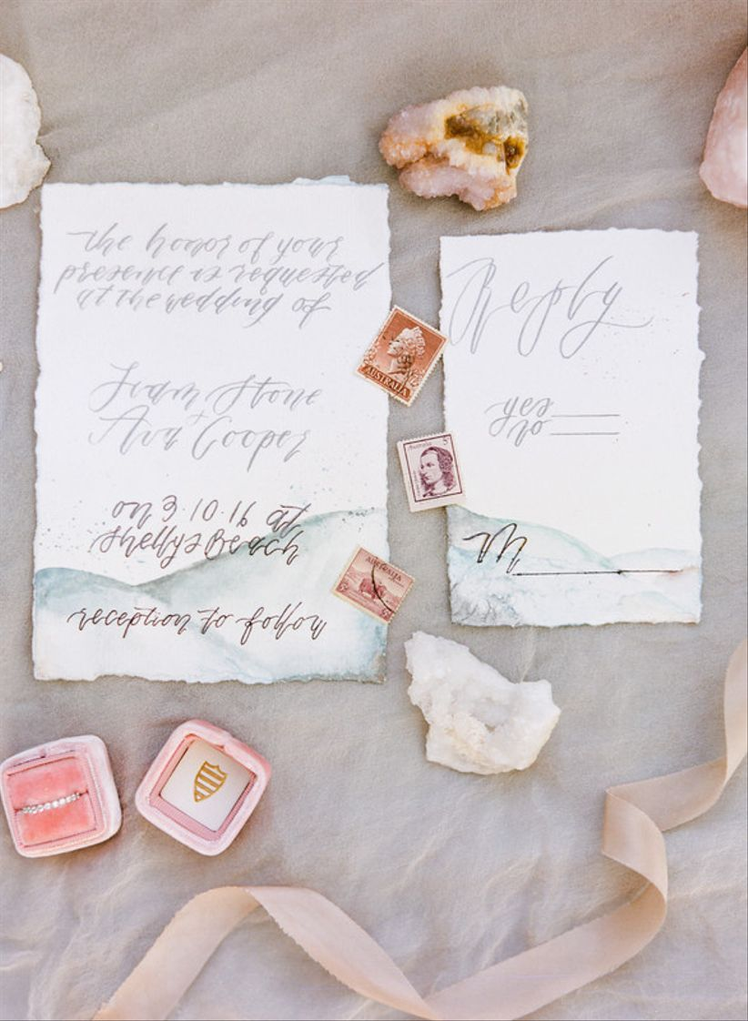 abstract watercolor wedding invitation suite with blue and blush colors