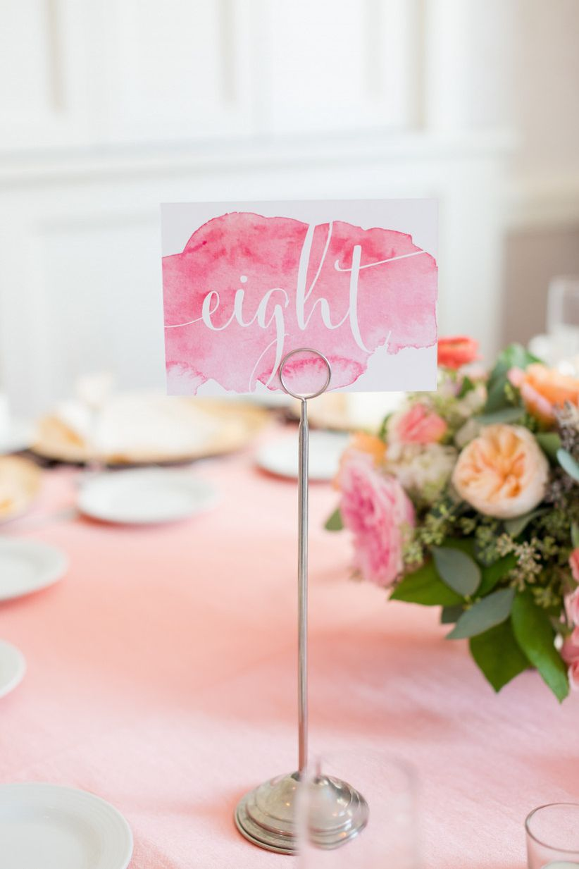 pink watercolor table number for wedding reception centerpiece