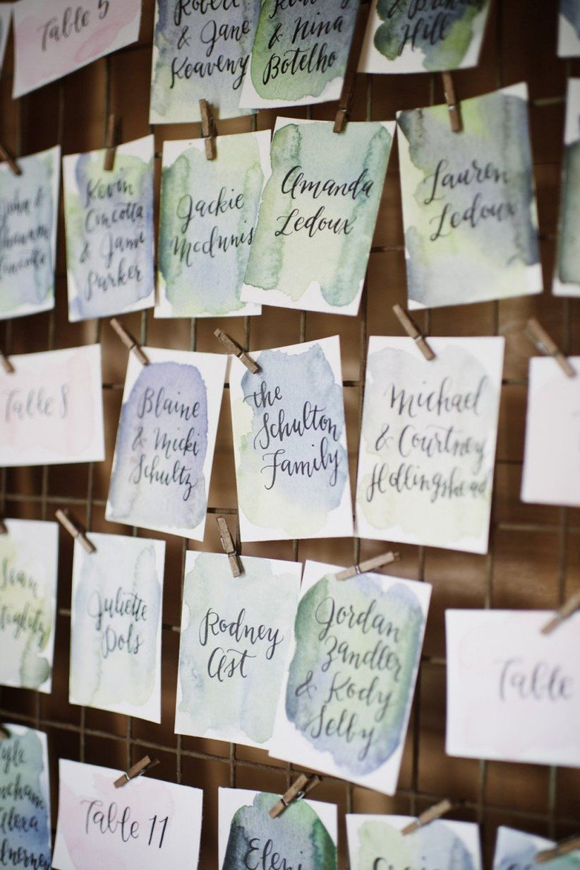 watercolor wedding escort cards with green and blue color palette
