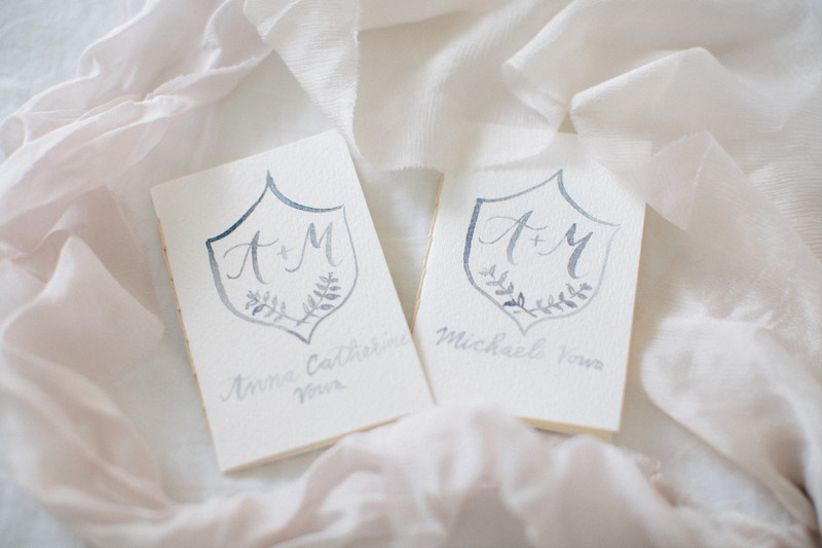 wedding vow notebooks painted with light blue watercolor monogram