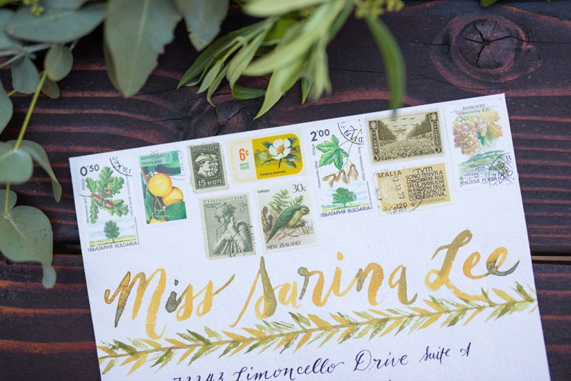 watercolor wedding invitation envelope with painted address label and vintage garden stamps
