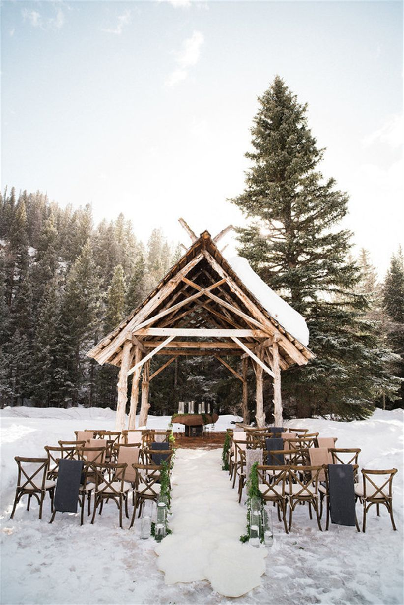 outdoor winter wedding ceremony in the snow