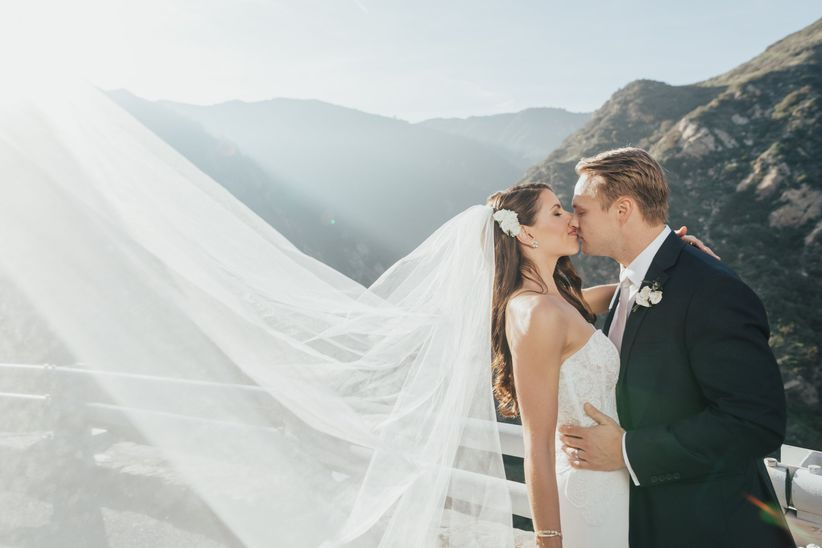 couple kissing bride with veil