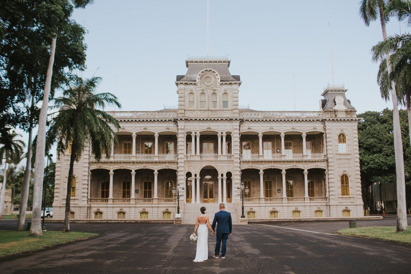 couple standing in front of wedding venue