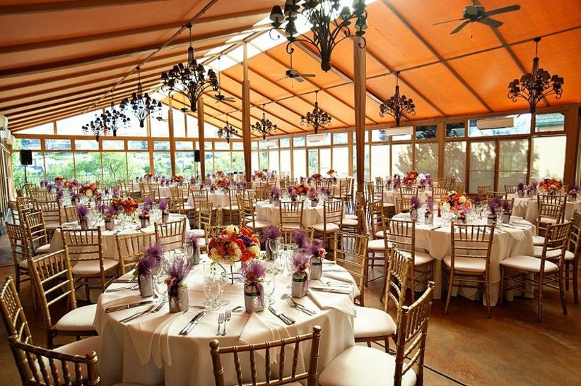 indoor wedding reception with glass-wall pavilion at Hiddenbrooke Golf Club in Sonoma, California