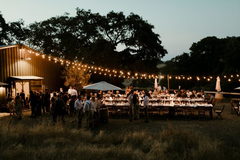 nighttime barn wedding reception with bistro lights in Cloverdale, California