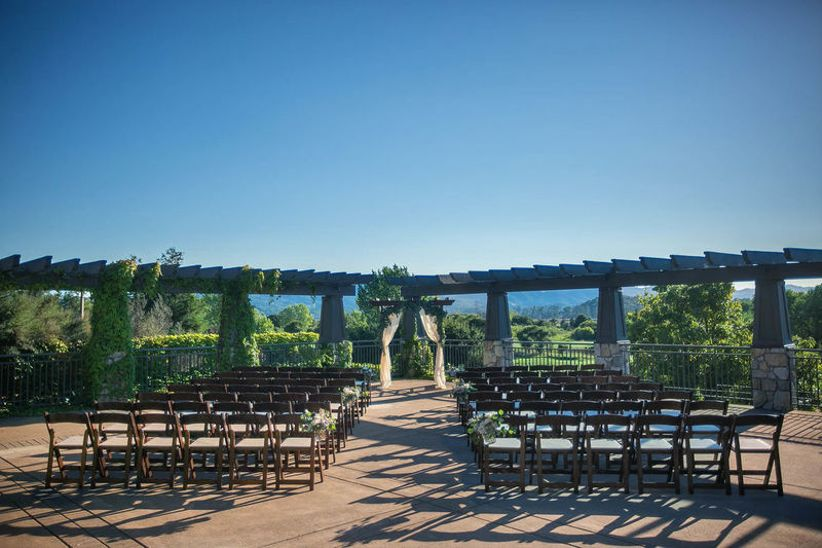 outdoor wedding ceremony site with wooden pergola overlooking Sonoma, California vineyards