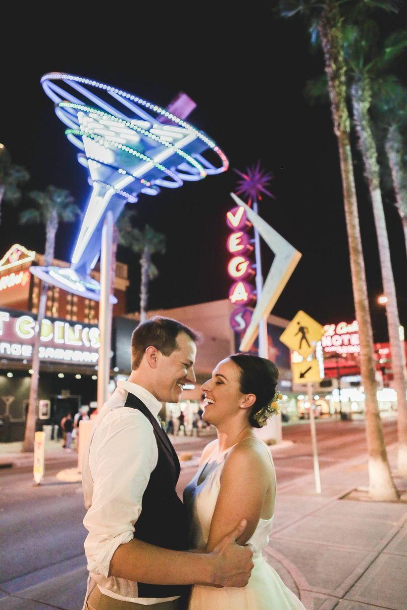 bride and groom pose on Las Vegas strip downtown Las Vegas wedding