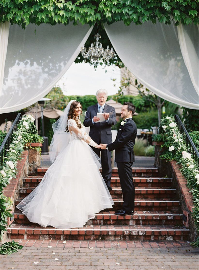 bride and groom stand at ceremony venue at winery wedding venue in Sonoma California