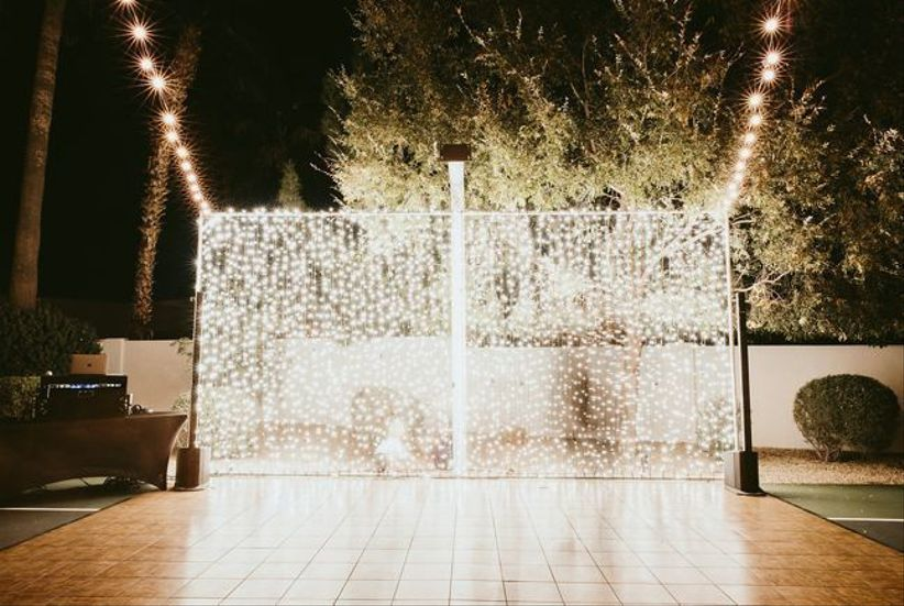 outdoor wedding dance floor with string light backdrop