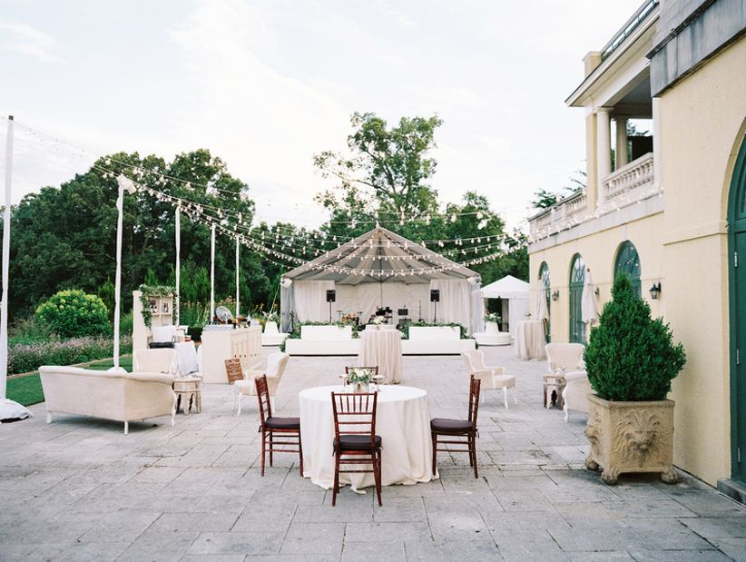 Outdoor wedding reception lighting ideas Rustic Outdoor Wedding Reception Venue With Bistro Lights And Round Tables Wallico 20 Romantic Wedding Lighting Ideas To Make You Swoon Weddingwire