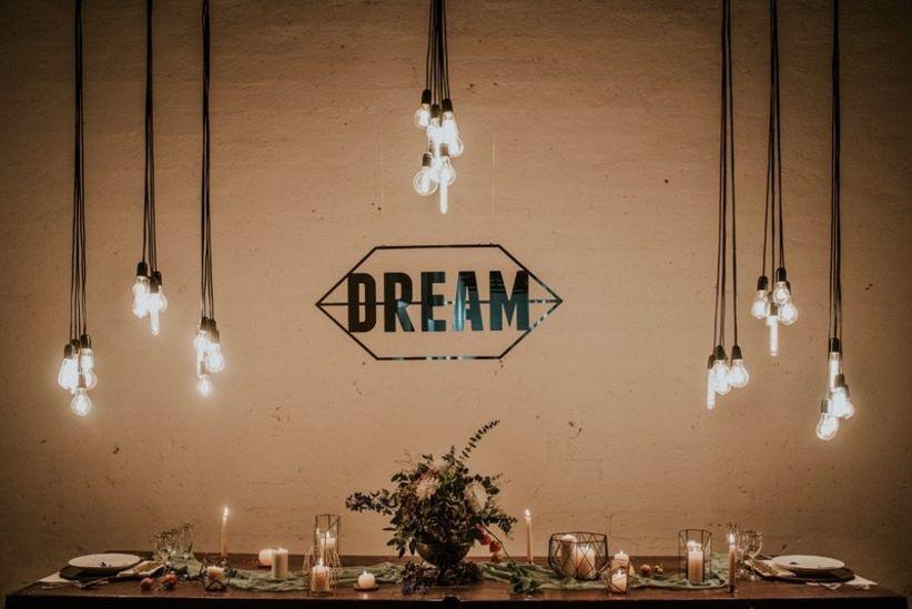 modern wedding sweetheart table with Edison bulb lamps