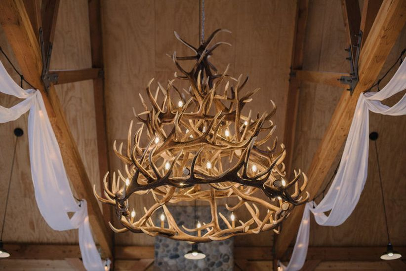 rustic antler chandelier at barn wedding venue
