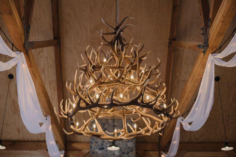 rustic antler chandelier at barn wedding venue