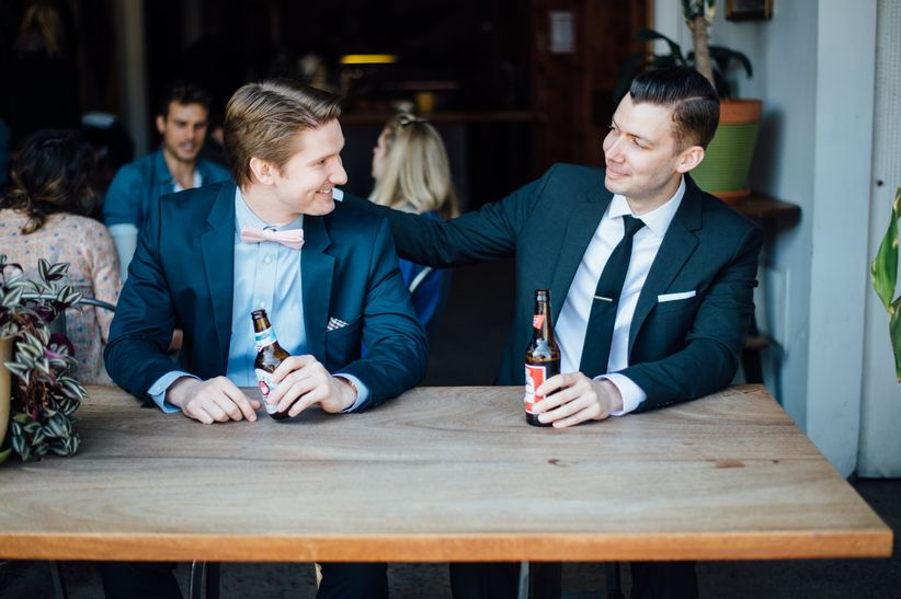 groom and best man drinking beers