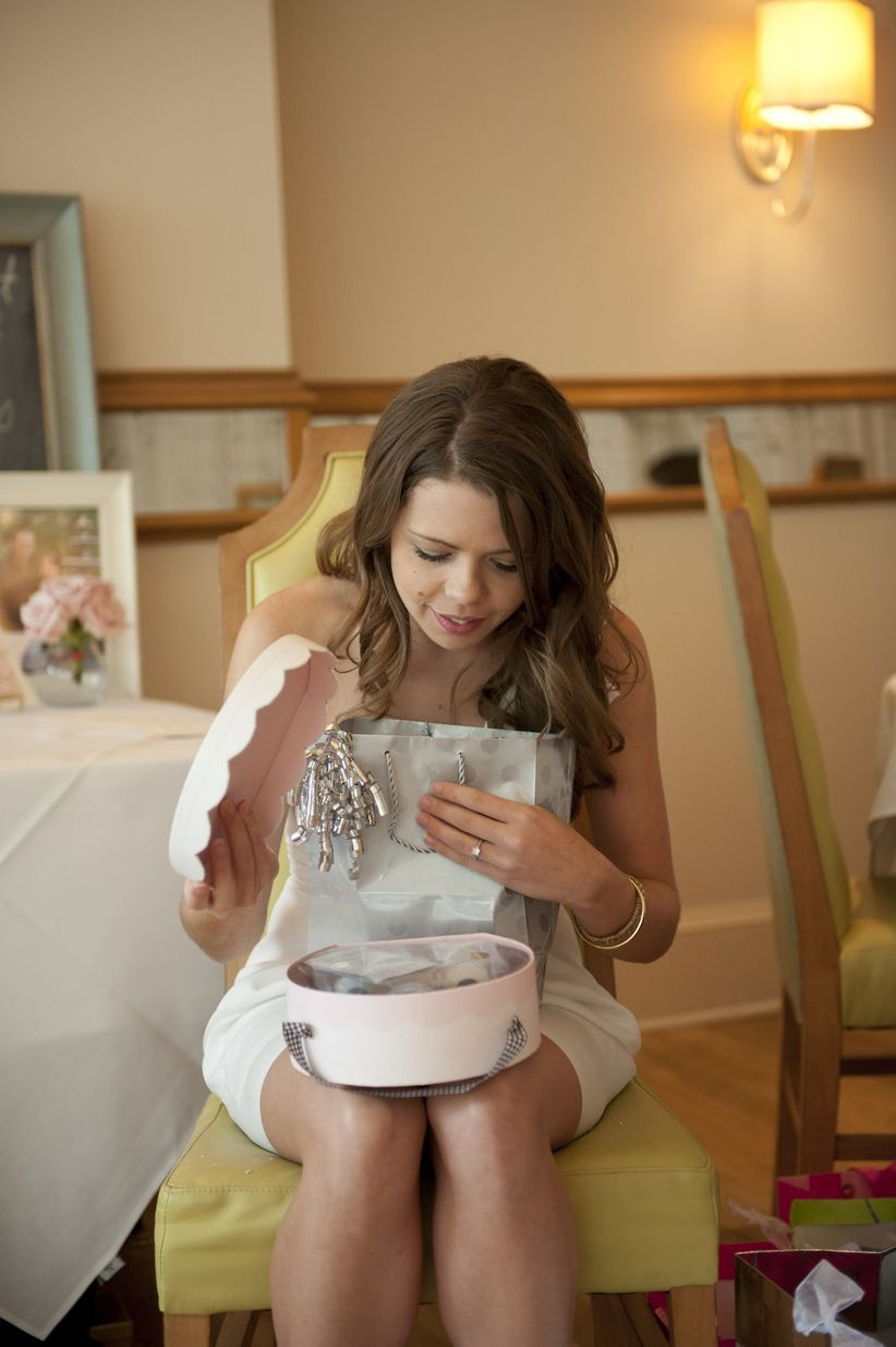 bride opening bridal shower gift