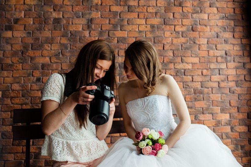 bride with wedding photographer