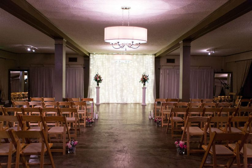 ballroom wedding venue with polished concrete floors and chandeliers
