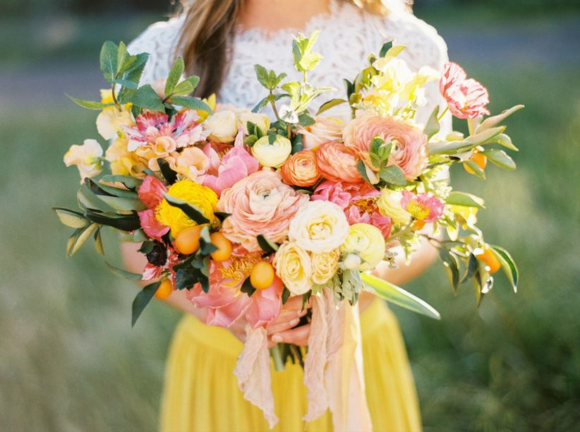 pink and orange yellow wedding bouquet with kumquats