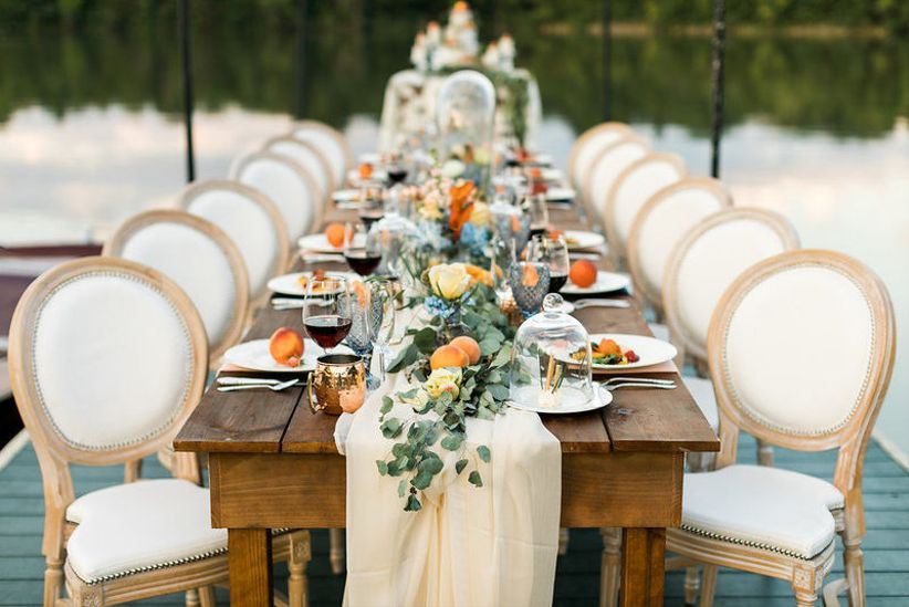 long banquet table with low centerpieces and greenery table runner