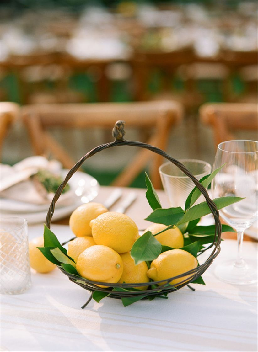 wedding centerpiece with lemons in a basket