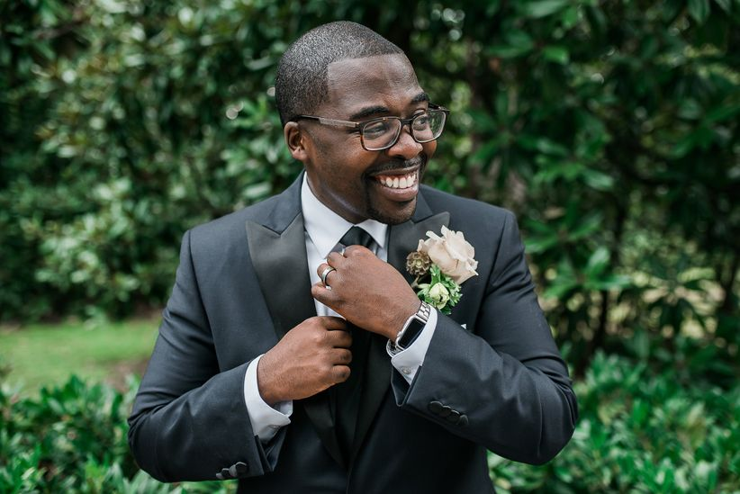 groom straightening his tie