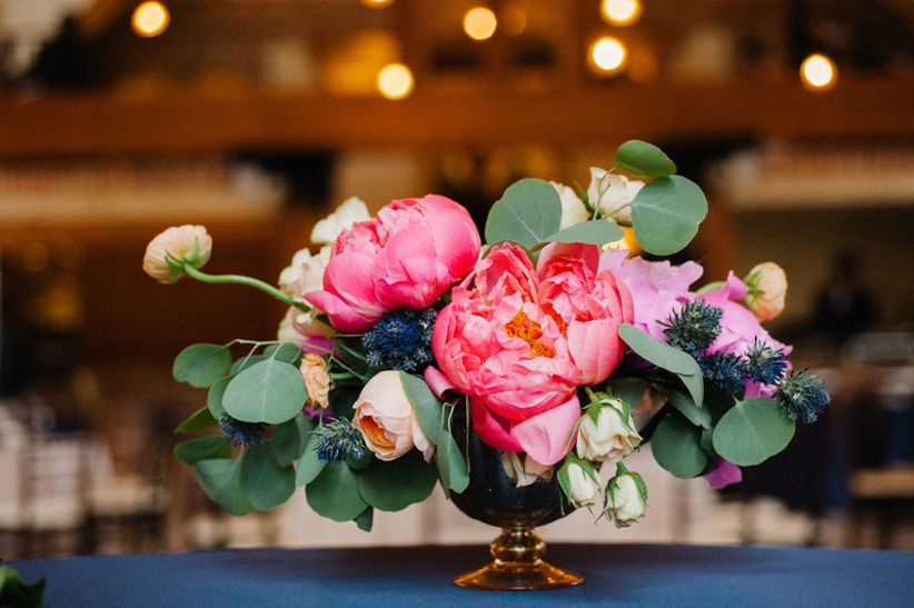 wedding centerpiece with pink peonies and greenery