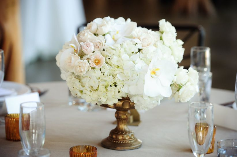 classic white wedding centerpiece with roses, hydrangeas and phalaenopsis orchids