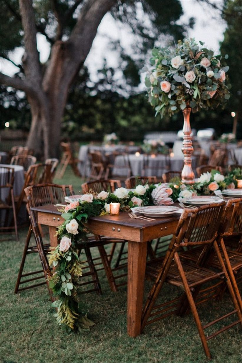 rattan chairs at outdoor wedding reception