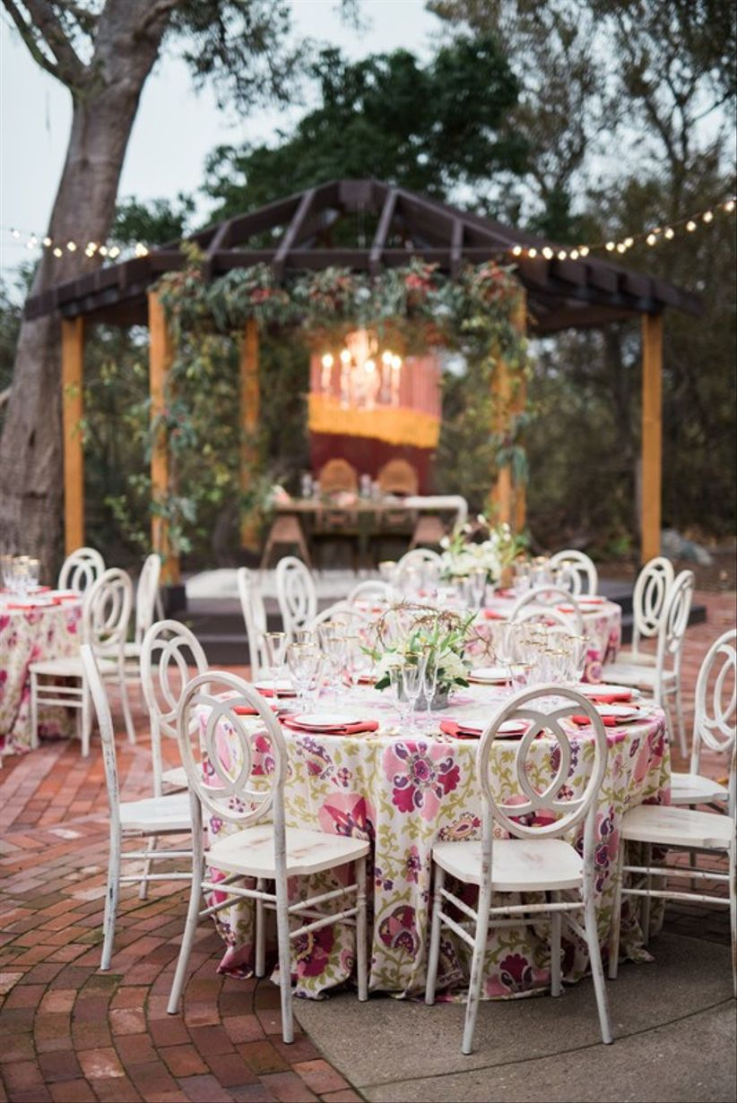 white infinity chairs outdoor wedding reception