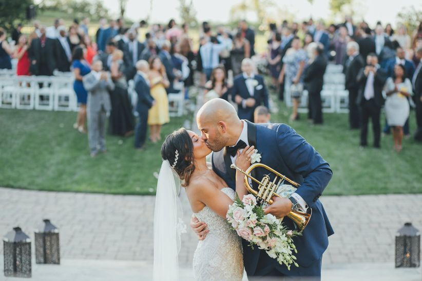 bride and groom kiss after wedding ceremony