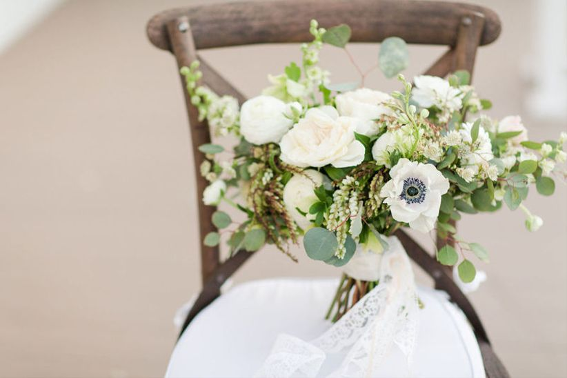 winter wedding bouquet with pieris and anemones