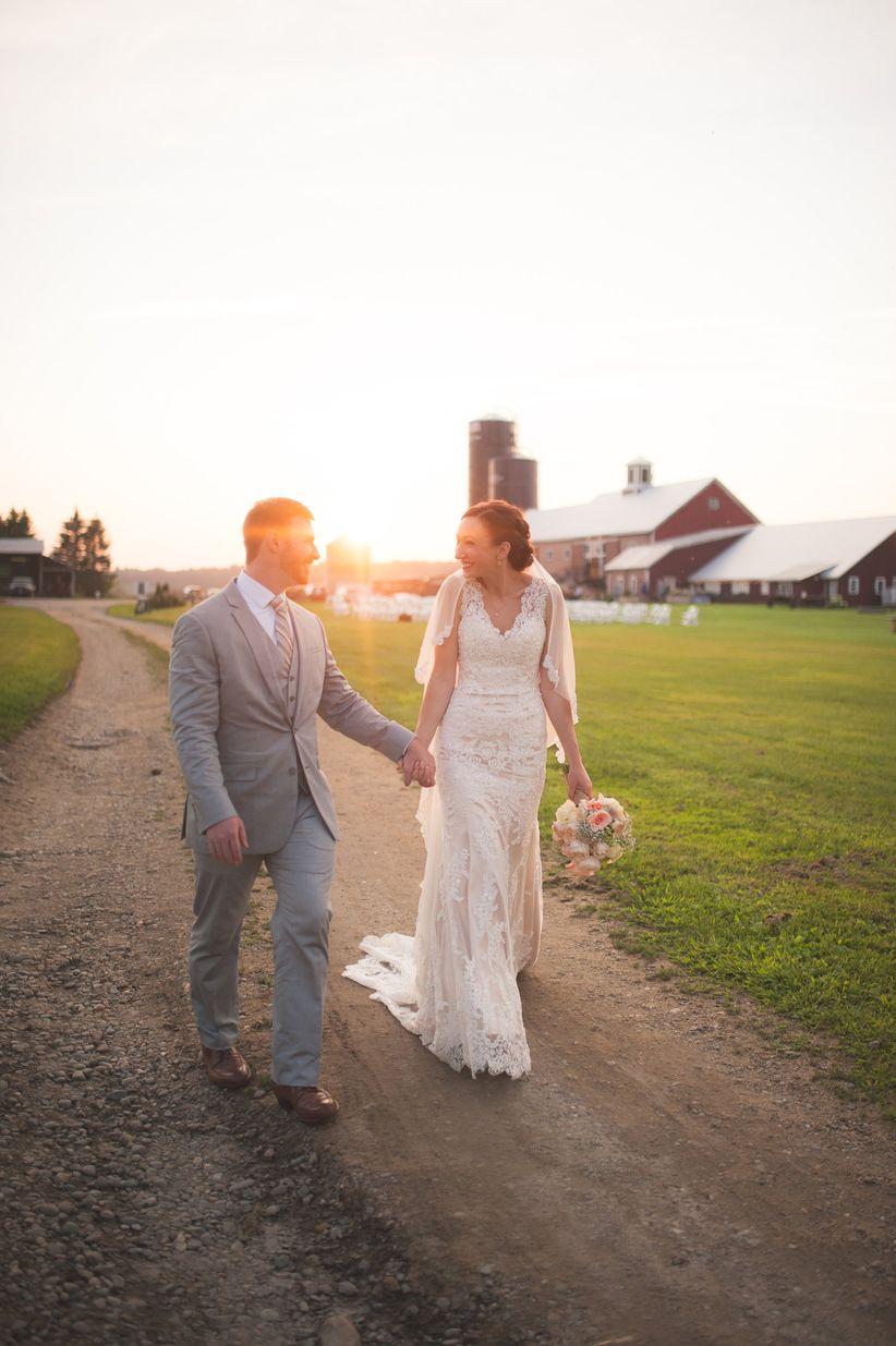 couple walking barn venue