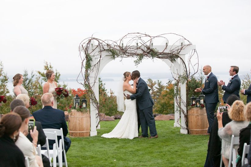couple kissing at outdoor wedding ceremony