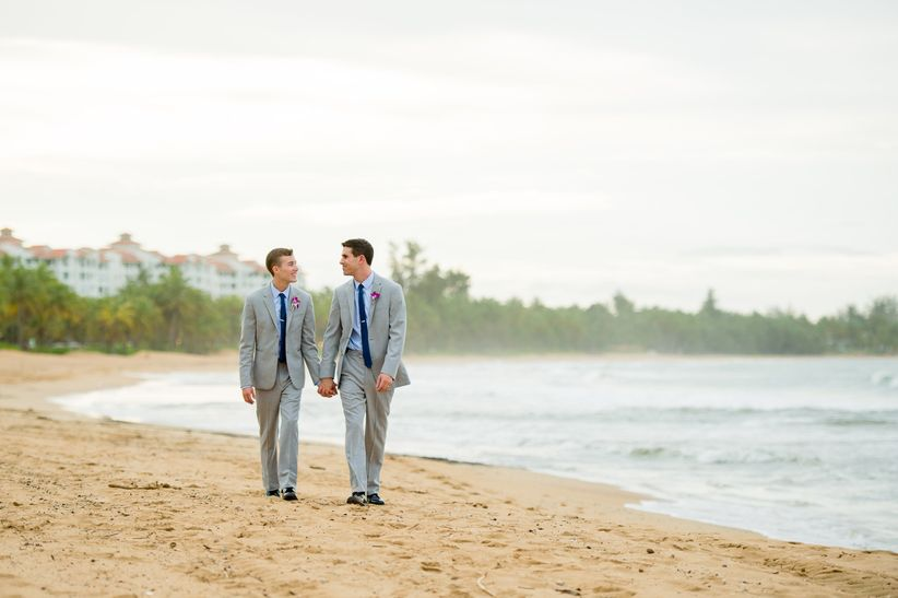 same sex couple wedding walking on beach