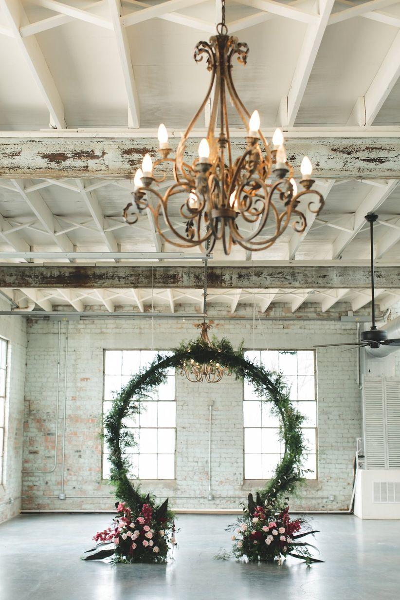 oversized floral wreath wedding backdrop