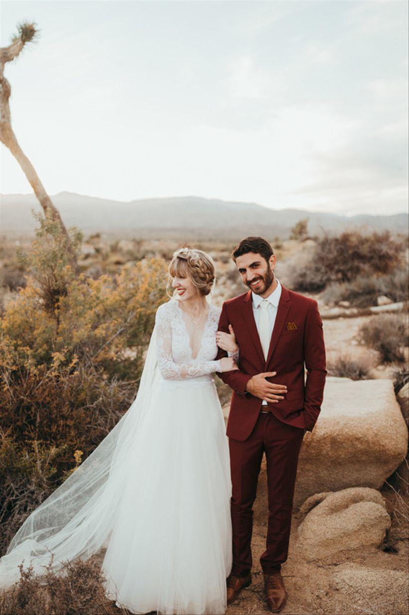 bohemian groom wearing burgundy suit